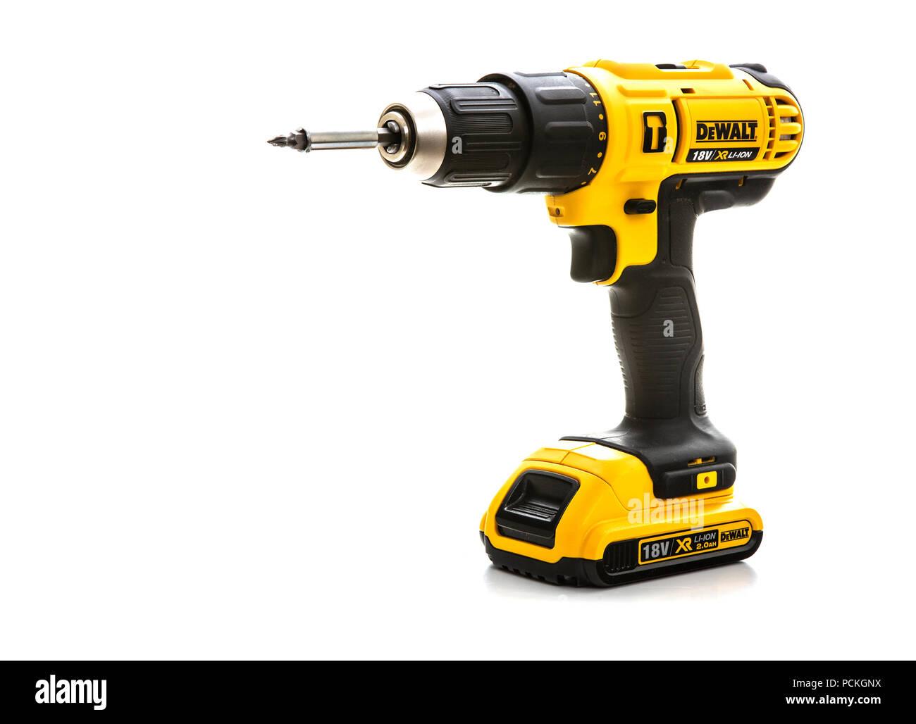 SWINDON, UK - JULY 31, 2018: DeWalt cordless power drill on a white background - Stock Image