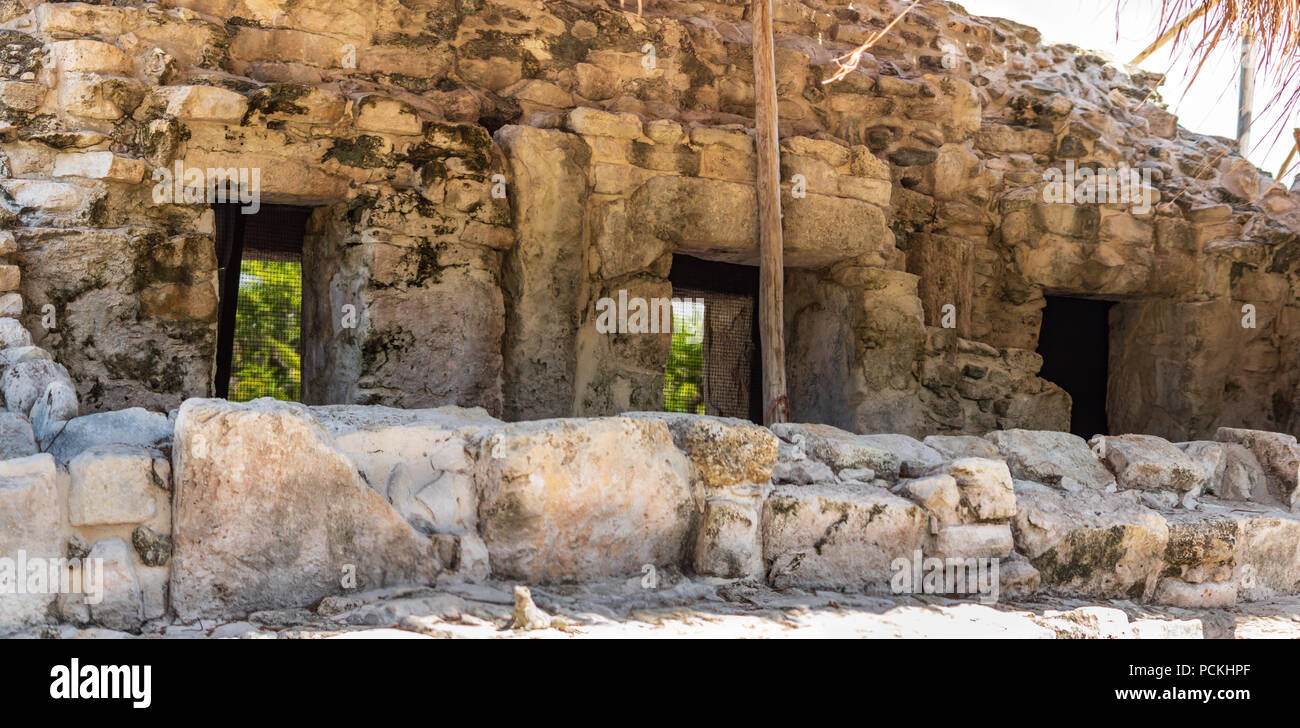 Mayan ruins in Cancun.  Small mayan town is now in ruins. These doors are not reconstructions but preserved originals - Stock Image