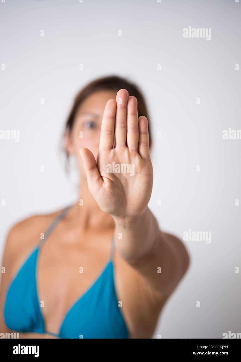women in bikini says stop - Stock Image