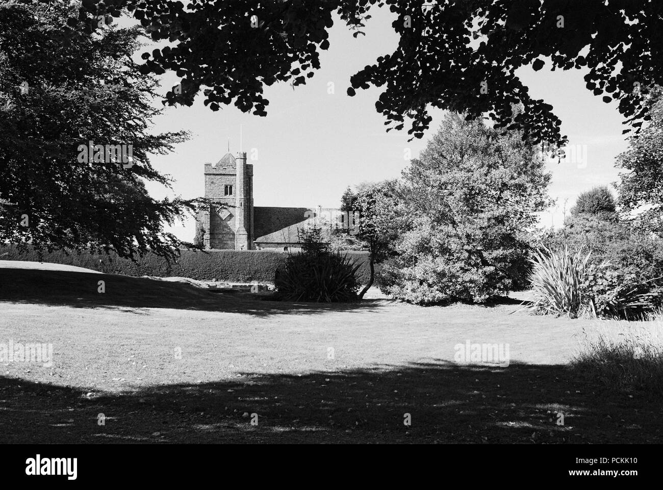 St Mary's church, Battle East Sussex, UK, viewed from the grounds of Battle Abbey, in summertime - Stock Image