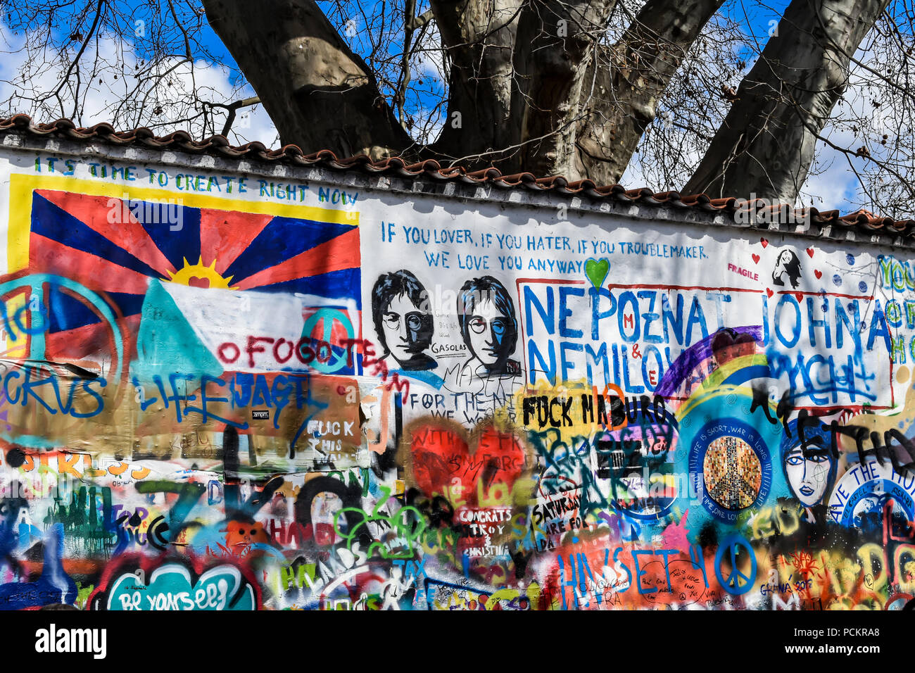 The Lennon Wall is a wall in Prague. Once a normal wall, since the 1980s it has been filled with John Lennon-inspired graffiti and pieces of lyrics. - Stock Image