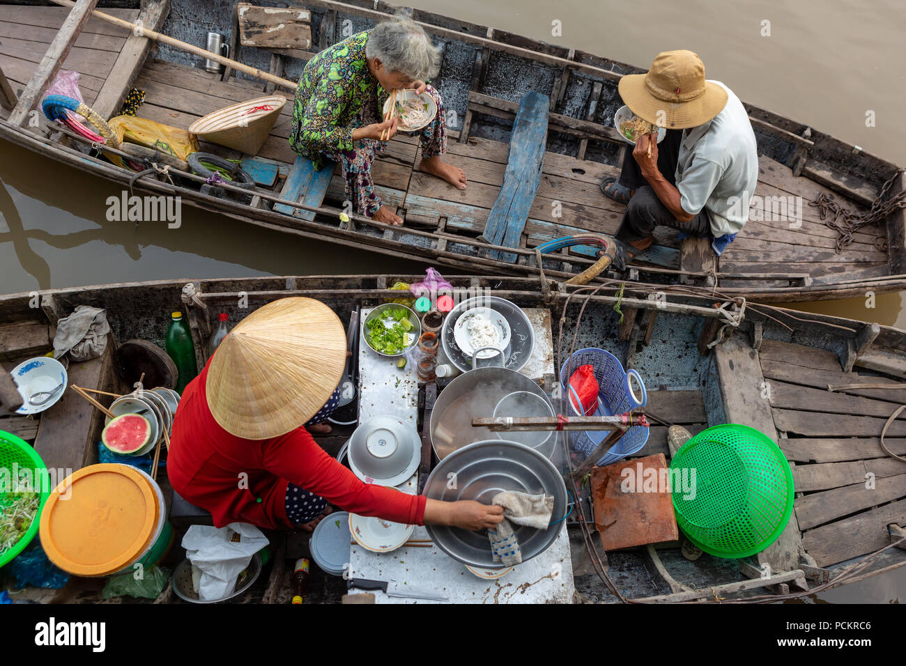 Soc Trang, Vietnam - April 5, 2018: Buying and selling agricultural products on Mekong River. Boat women sell fruit, flowers, agricultural products on Stock Photo