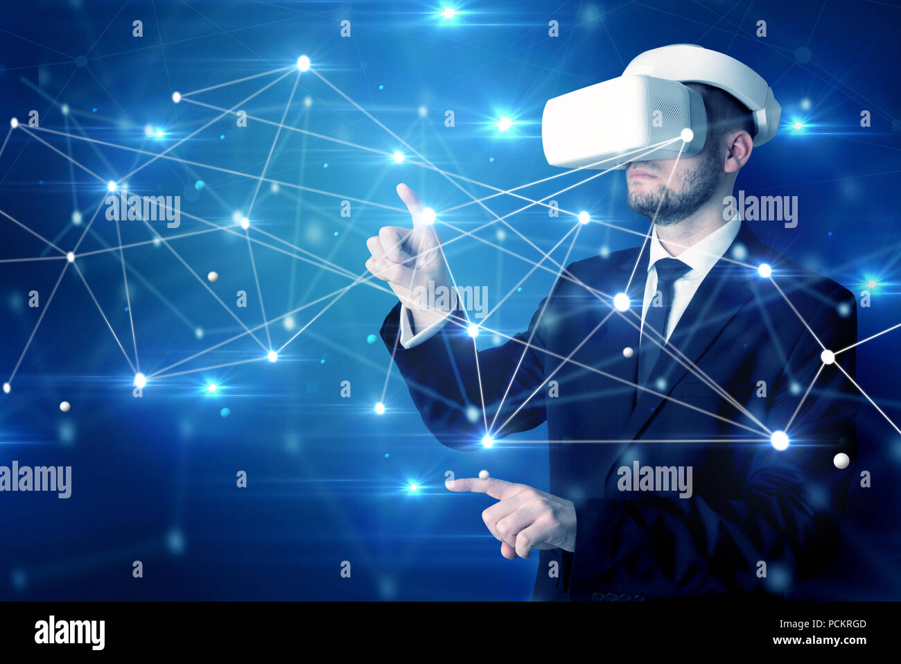 Businessman in virtual reality goggles investigate global network connectivity concept  - Stock Image