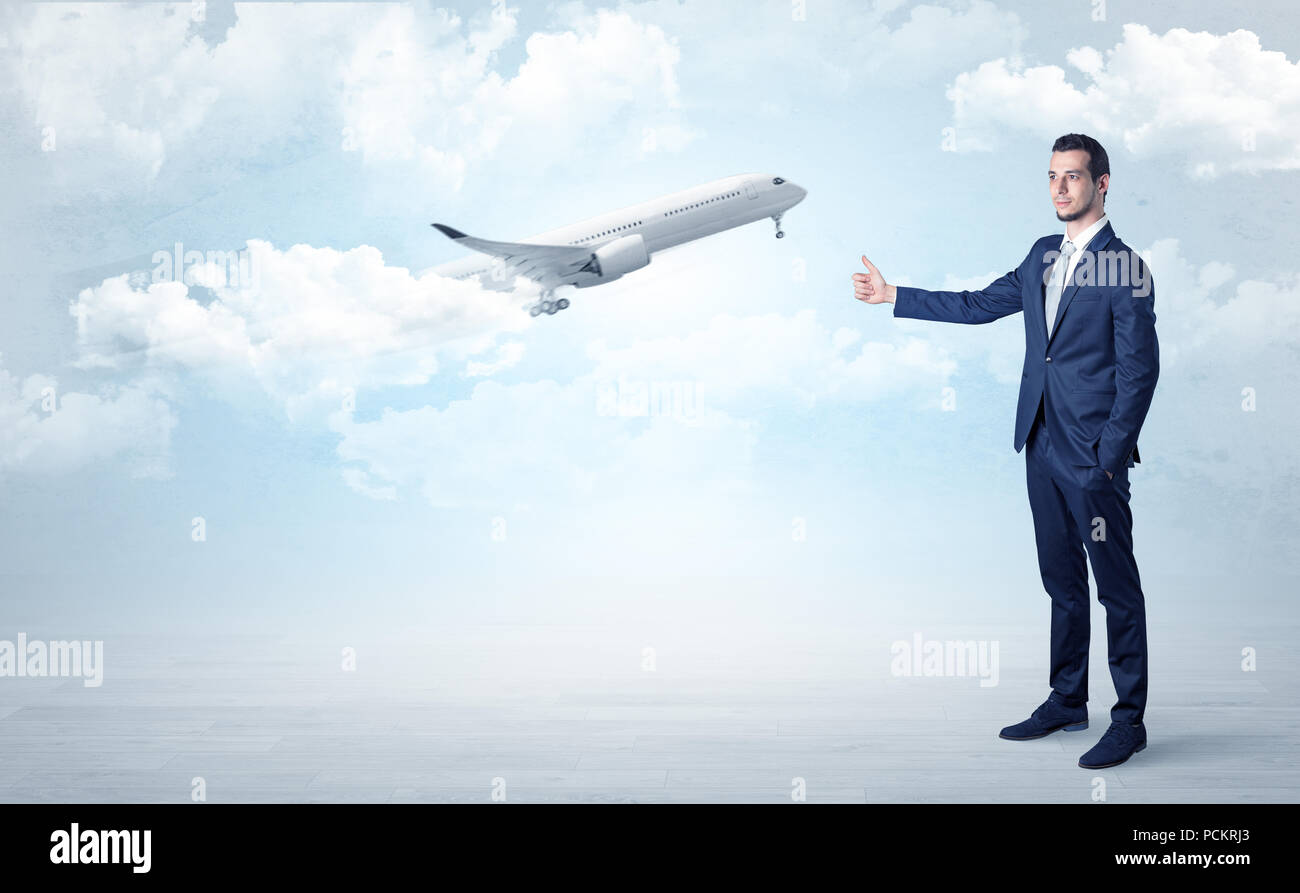Elegant agent hitchhiking with departing airplane concept - Stock Image