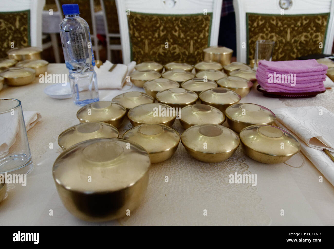 golden bowls and lids containing a sampling menu of north korean
