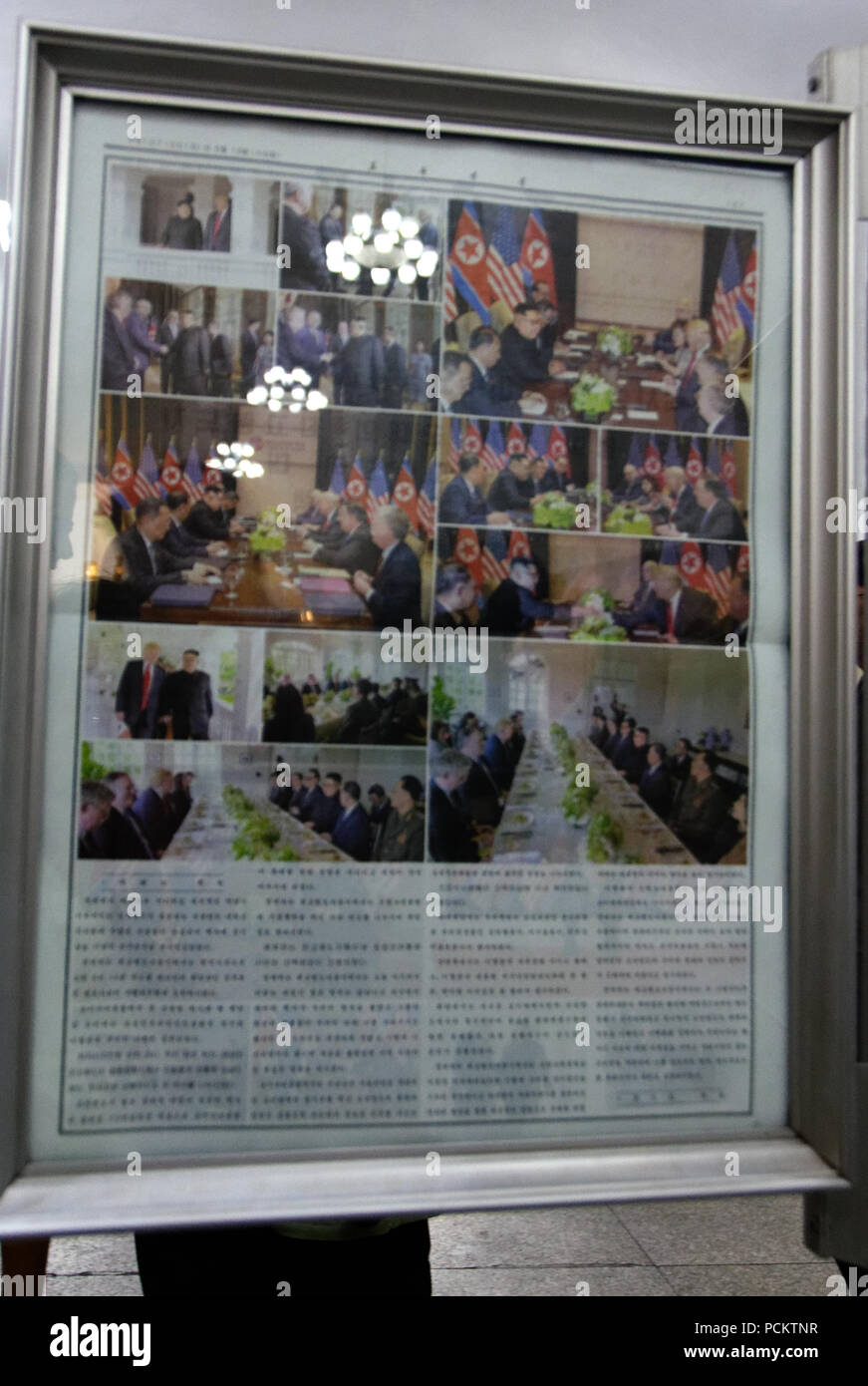 The summit meeting of Kim Jong-un and President Donald Trump is reported on the Pyongyang underground new bulletin boards. - Stock Image