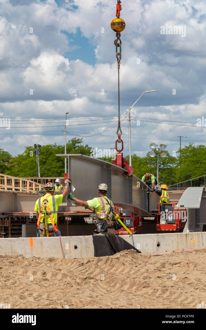 Detroit, Michigan - Workers set a girder in place while