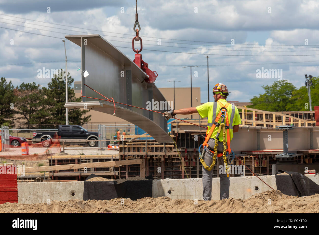 Detroit, Michigan - Workers set a girder in place while rebuilding a bridge on Interstate 94. Stock Photo