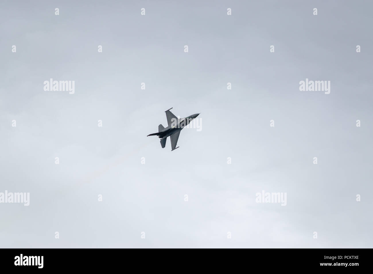 An F-16 performs a flypast at the 2018 Farnborough International Airshow - Stock Image