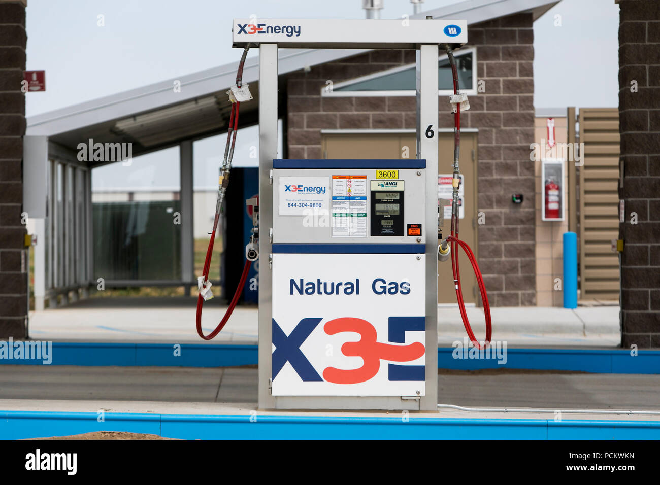 A logo sign outside of a X3Energy and Ward Alternative Energy natural gas fueling station in Greely, Colorado, on July 21, 2018. - Stock Image