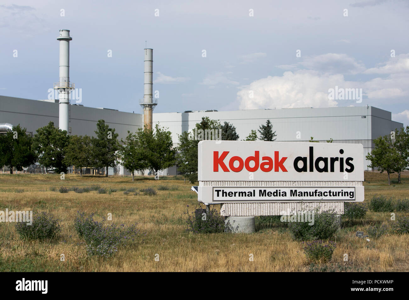 A logo sign outside of a facility occupied by Kodak Alaris