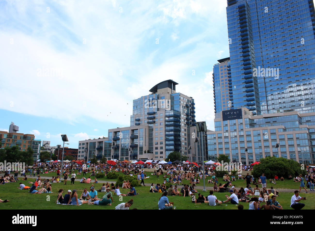 People resting on a lawn next to Smorgasburg in Williamsburg, Brooklyn on JULY 8th, 2017 in New York, USA. (Photo by Wojciech Migda) Stock Photo