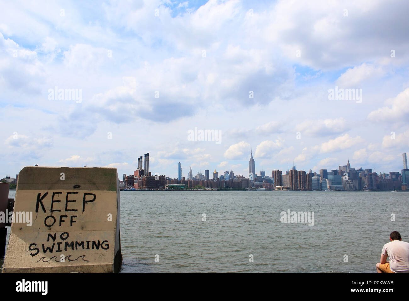 Keep off, no swimming graffiti on a concrete slab, Smorgasburg in Williamsburg, Brooklyn on JULY 8th, 2017 in New York, USA. (Photo by Wojciech Migda) Stock Photo