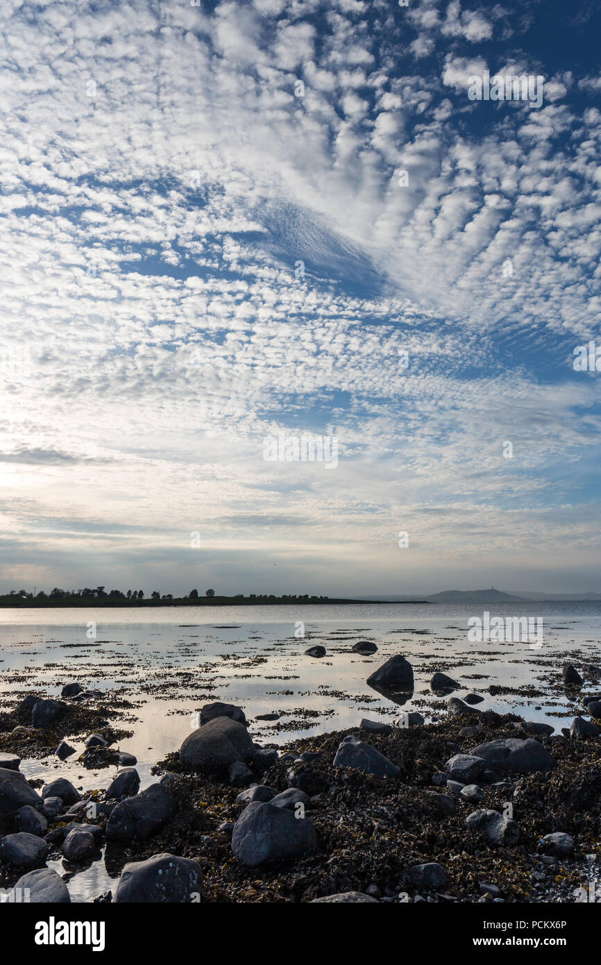 Stunning portrait skyscape and seascape overlooking Strangford Lough from Mahee Island, County Down, N.Ireland - Stock Image