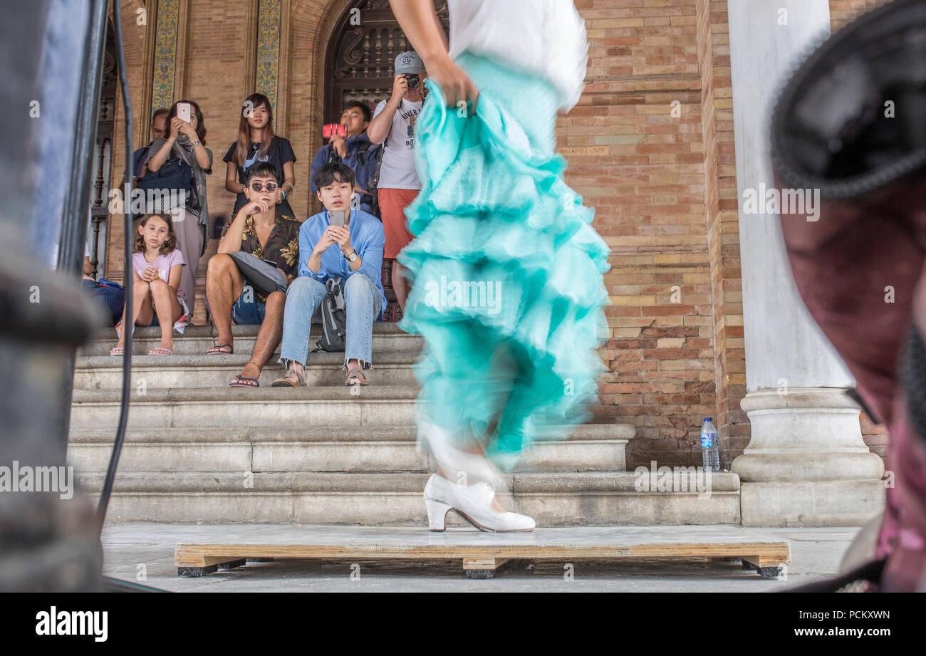 Seville, Spain - July 1st, 2018: Flamenco dancer performing at Plaza de España porch, Sevilla, Spain - Stock Image