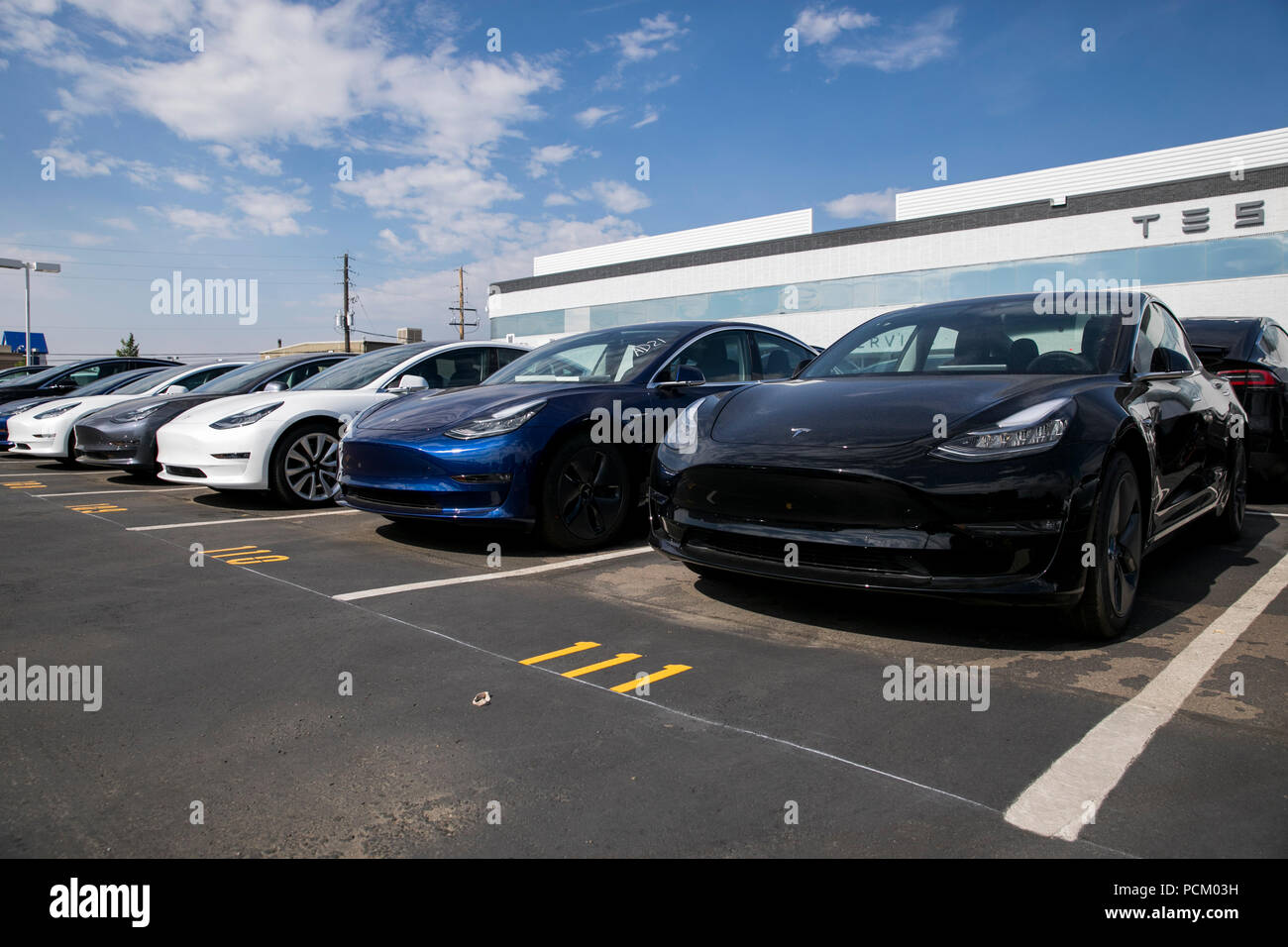 Tesla Model 3 electric vehicles at a Tesla Store location in Littleton, Colorado, on July 22, 2018. - Stock Image