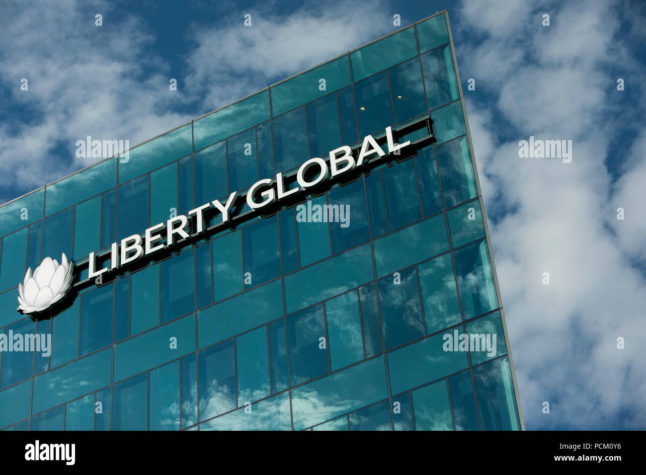 A logo sign outside of a facility occupied by Liberty Global in Denver, Colorado, on July 22, 2018. - Stock Image