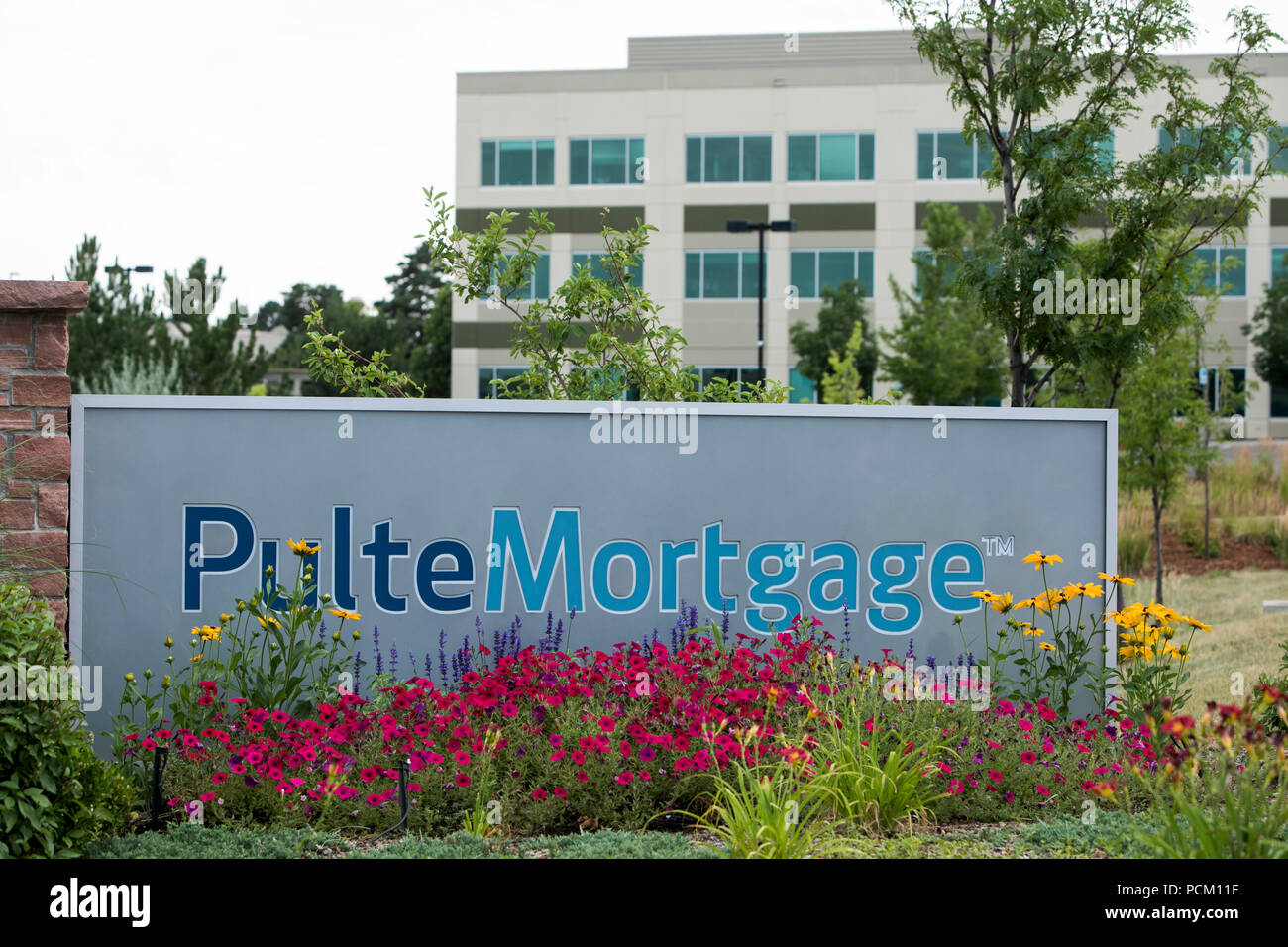 A logo sign outside of a facility occupied by Pulte Mortgage, a subsidiary of the PulteGroup, in Centennial, Colorado, on July 22, 2018. - Stock Image
