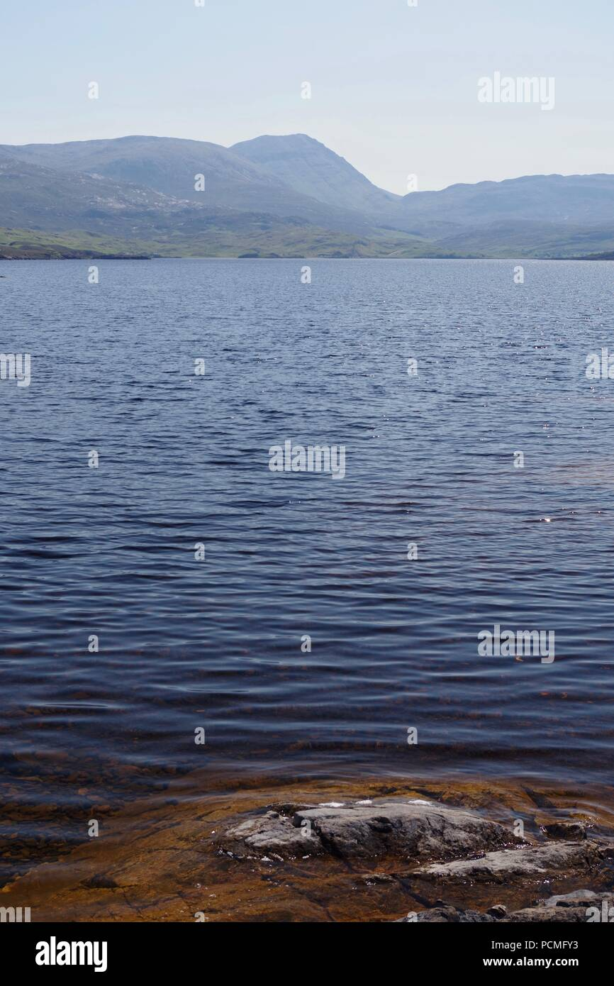 Rippled Water of l Loch Assynt on a Sunny Day, looking towards Glas Bheinn Peak. Sutherland, NW Scotland, UK. Summer, 2018. - Stock Image