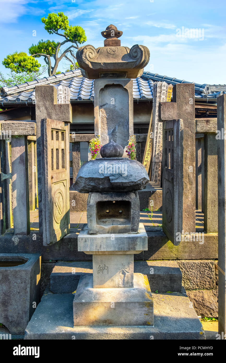 TOKYO, JAPAN - APRIL 20 2018: Grave of lady Ako master of 47 ronin, loyal masterless samurai, one of the most popular Japanese historical epic legends - Stock Image
