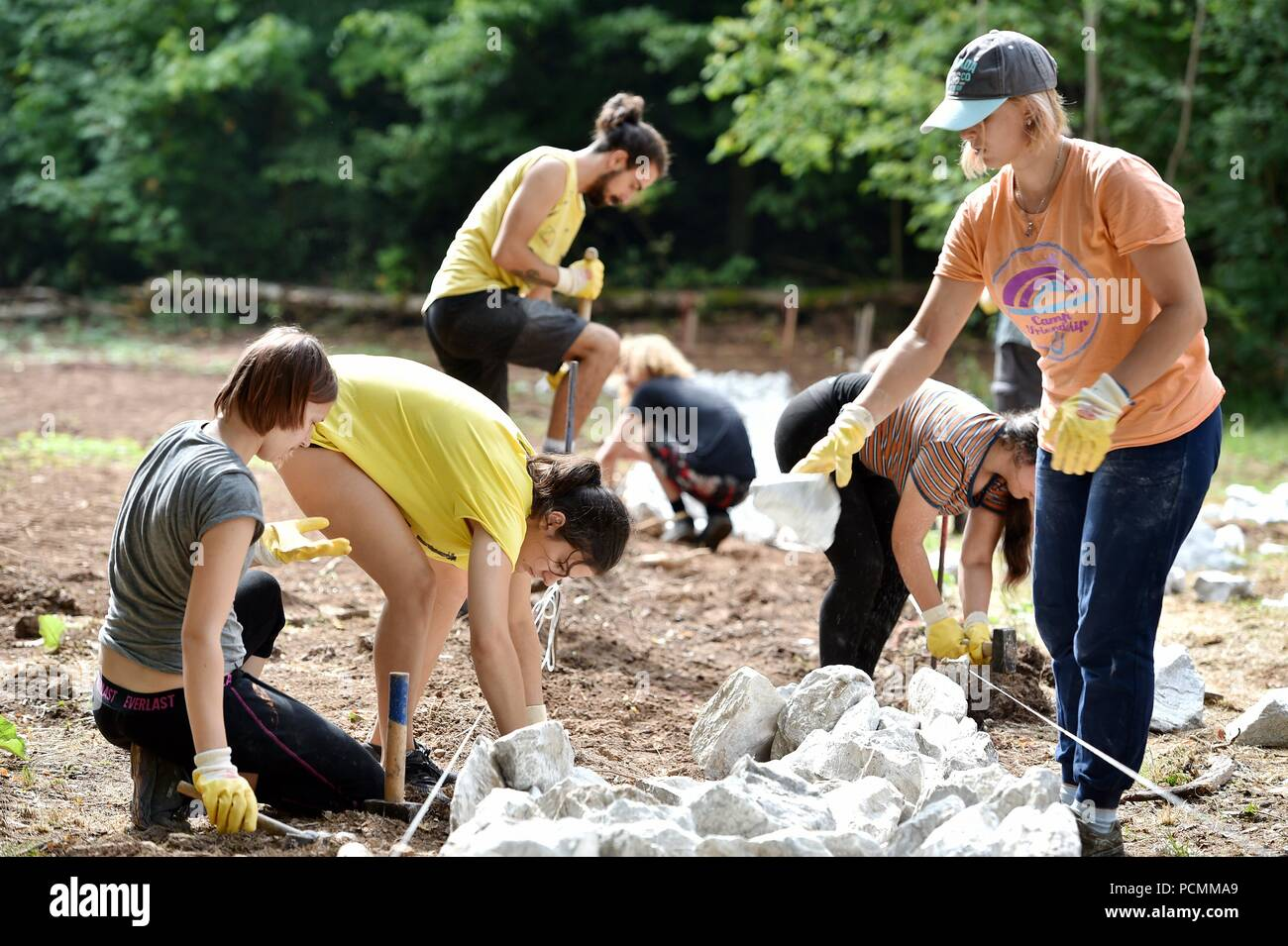 Nordhausen, Germany. 02nd Aug, 2018. An international youth group works in the Mittelbau-Dora concentration camp memorial. In the former Nazi concentration camp, young people from eight countries uncover the foundations of a prisoners' barrack. Credit: Frank May/dpa/Alamy Live News - Stock Image