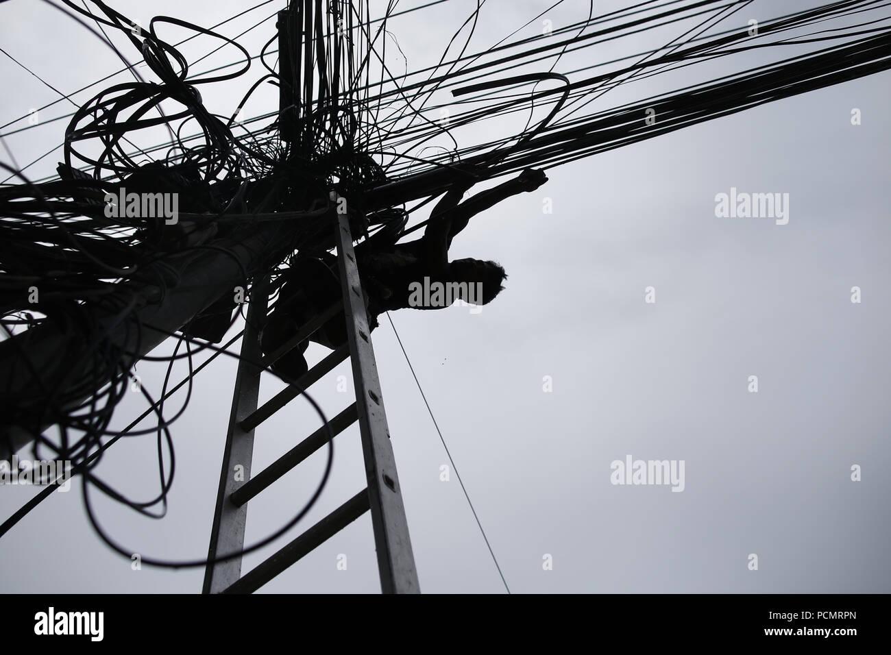 August 3, 2018 - Kathmandu, Nepal - An electrician fi ... on
