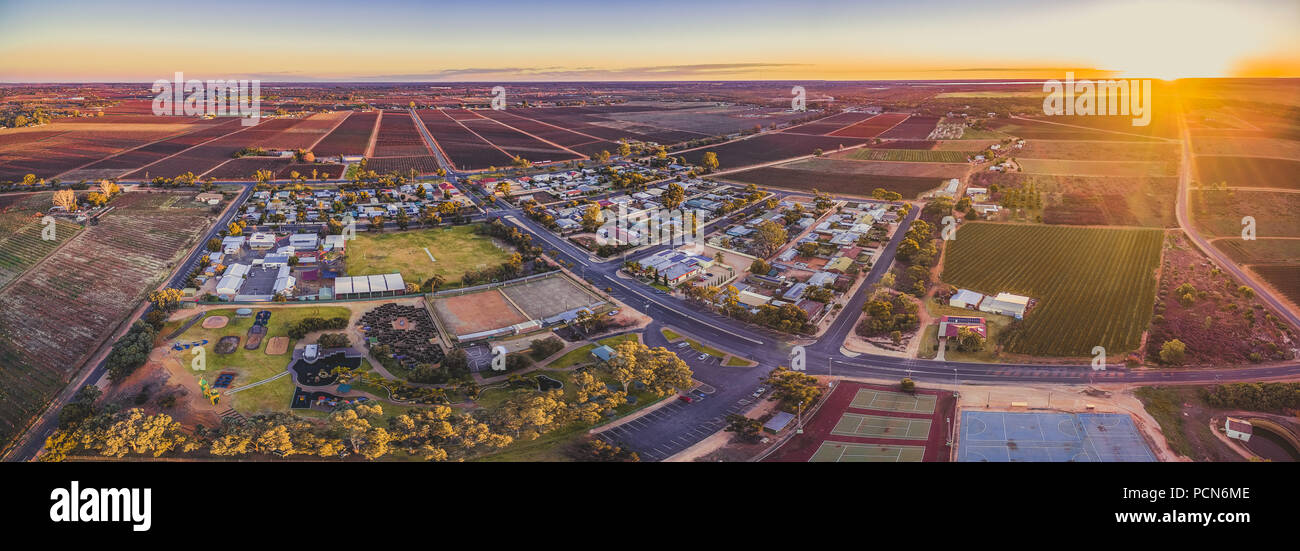 Aerial panorama of Monash - small town in South Australia and farmlands at sunset - Stock Image