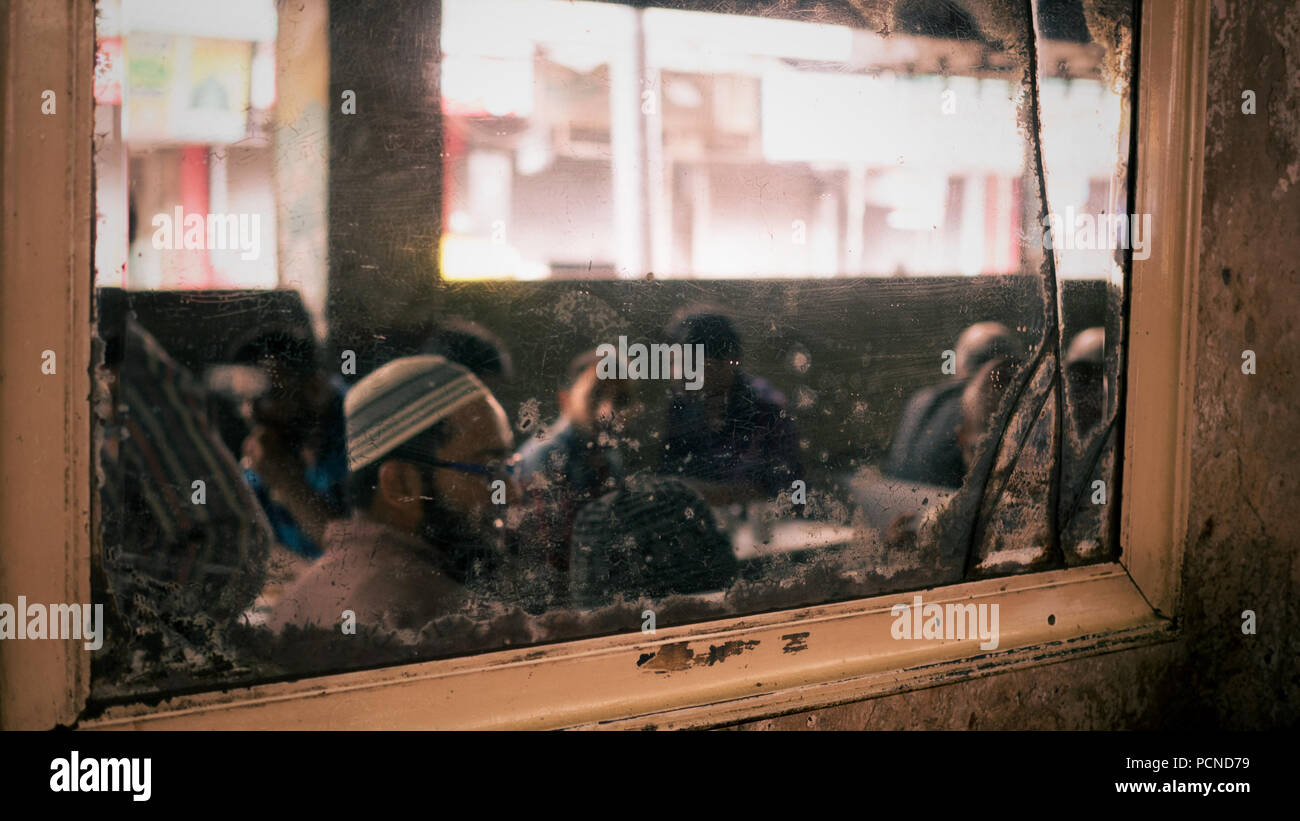 Men in a restaurant, Ahmedabad, Gujurat - Stock Image