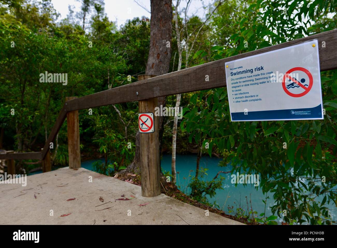 No swimming swimming risk sign, Cardwell Spa Pool, Cardwell, Queensland, Australia Stock Photo