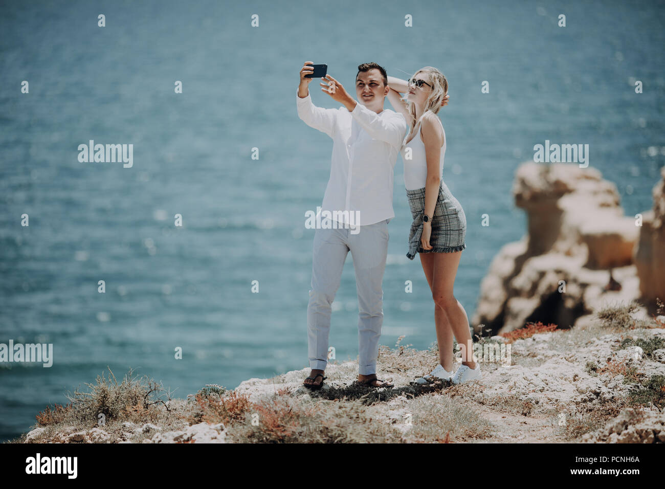 couple taking selfie self portrait photo romantic. Happy lovers, woman and man traveling on vacation - Stock Image