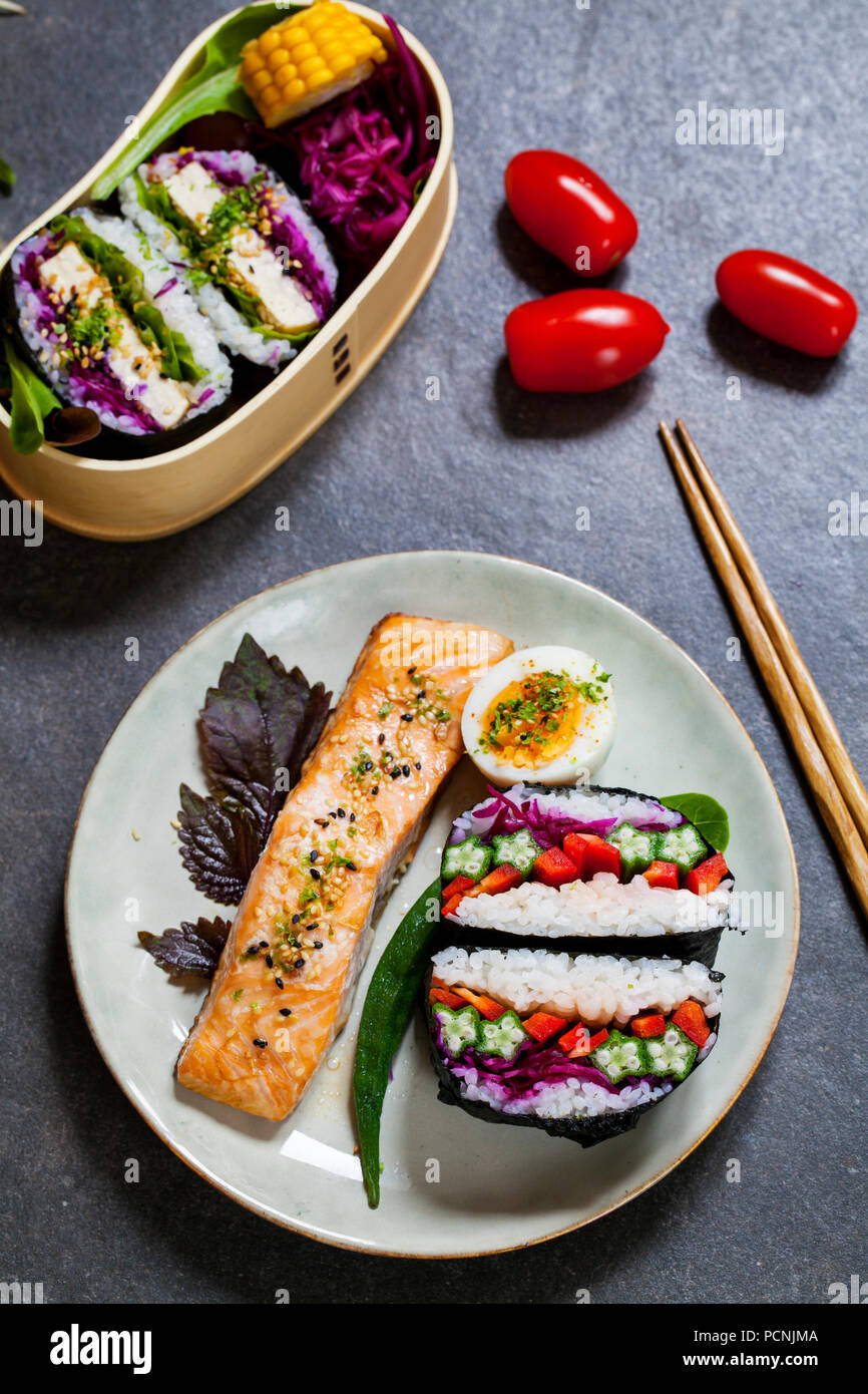 Japanese lunch with tofu onigirazu and salmon - Stock Image