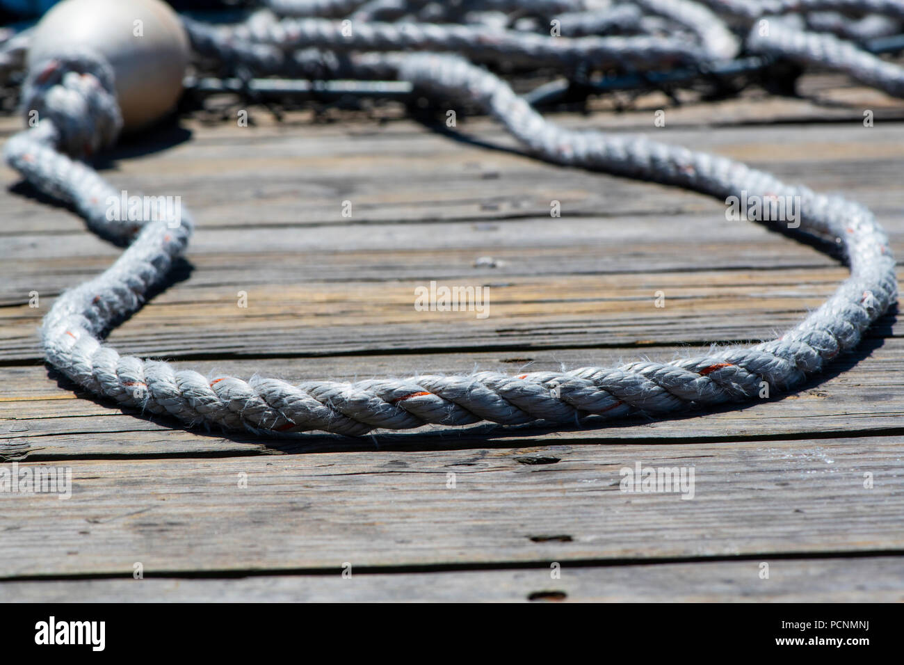 Rope on a pier - Stock Image