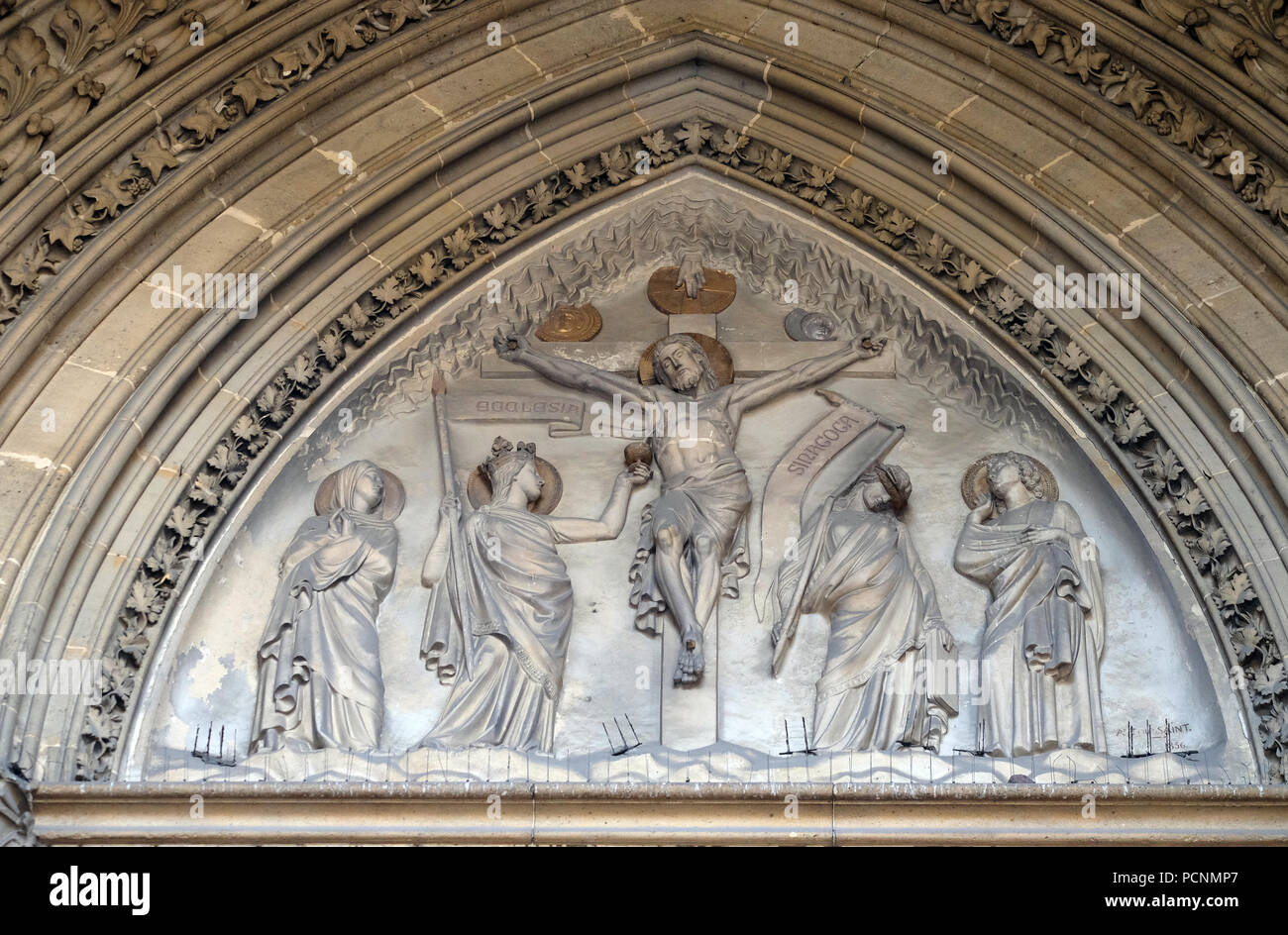 Crucifixion bass relief on the portal of the Basilica of Saint Clotilde in Paris, France Stock Photo