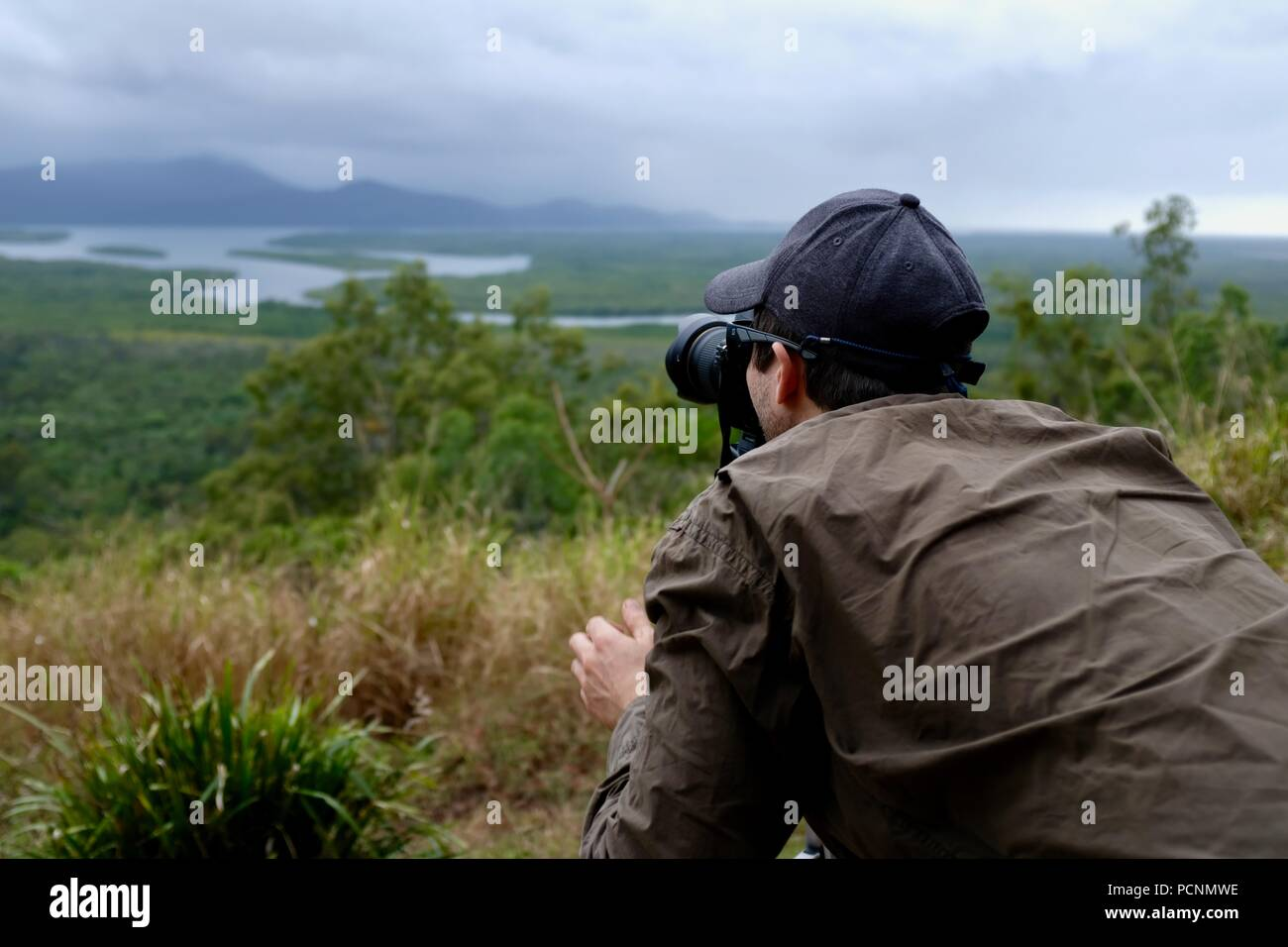 A man taking a photograph at the Panjoo Lookout, Cardwell, Queensland, Australia - Stock Image