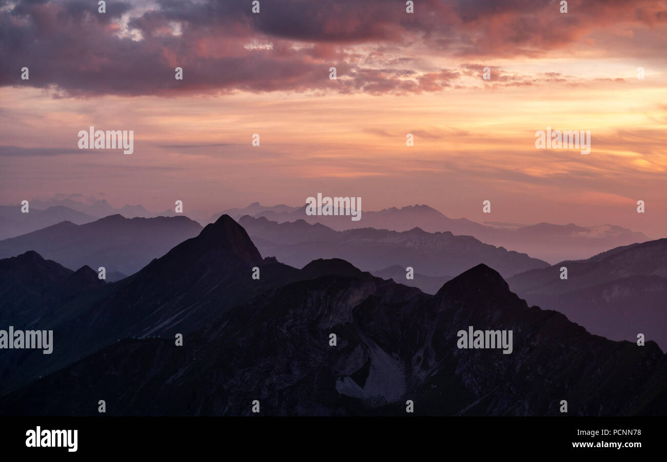 dramatic sunset over mountain range in the swiss alps brienzer rothorn switzerland Stock Photo