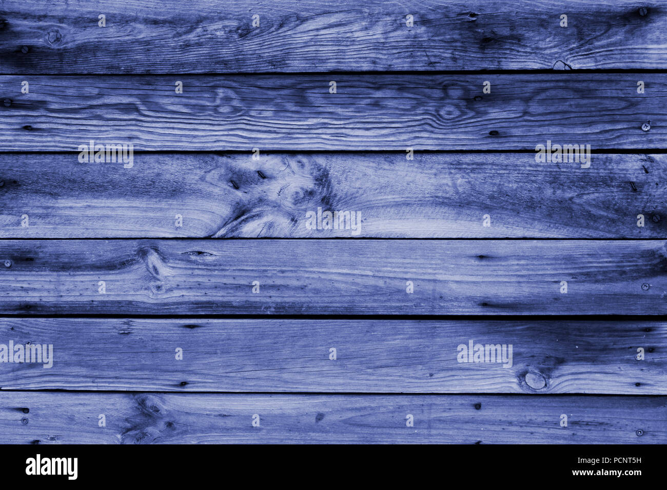 Close-up of the surface (wall, floor or overhead) made of wooden plank, panel or board in the dark blue, navy blue shades - Stock Image