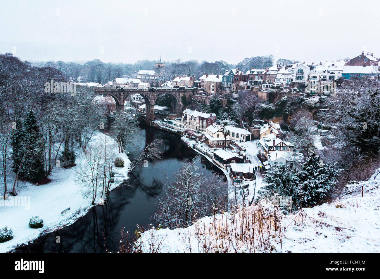 A winter landscape with viaduct in Knaresborough in North Yorkshire during snowy day in England. Winter photo in cool colors. - Stock Image