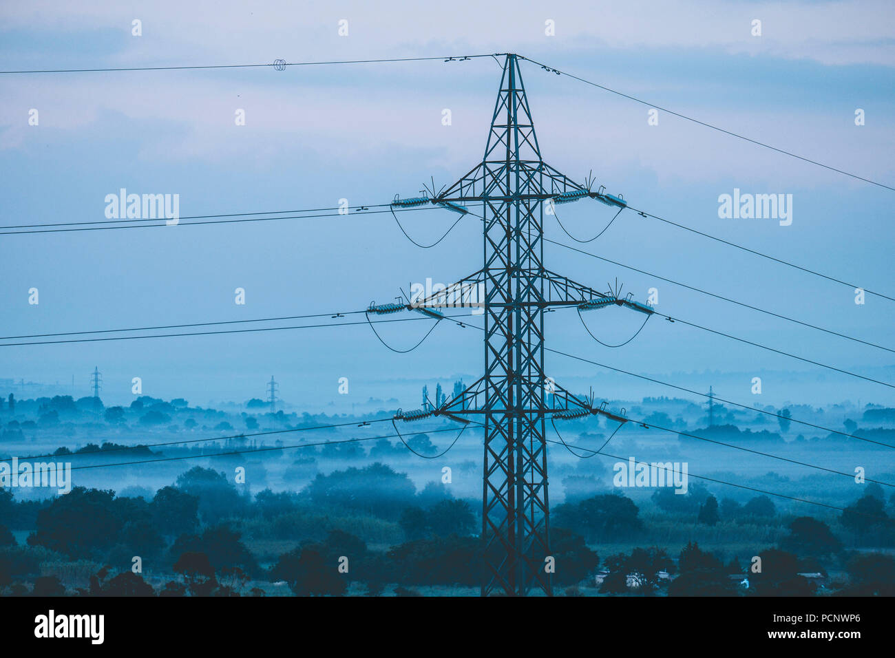 Electricity grid post during sunrise in the province of Gerona north of Catalonia Spain - Stock Image