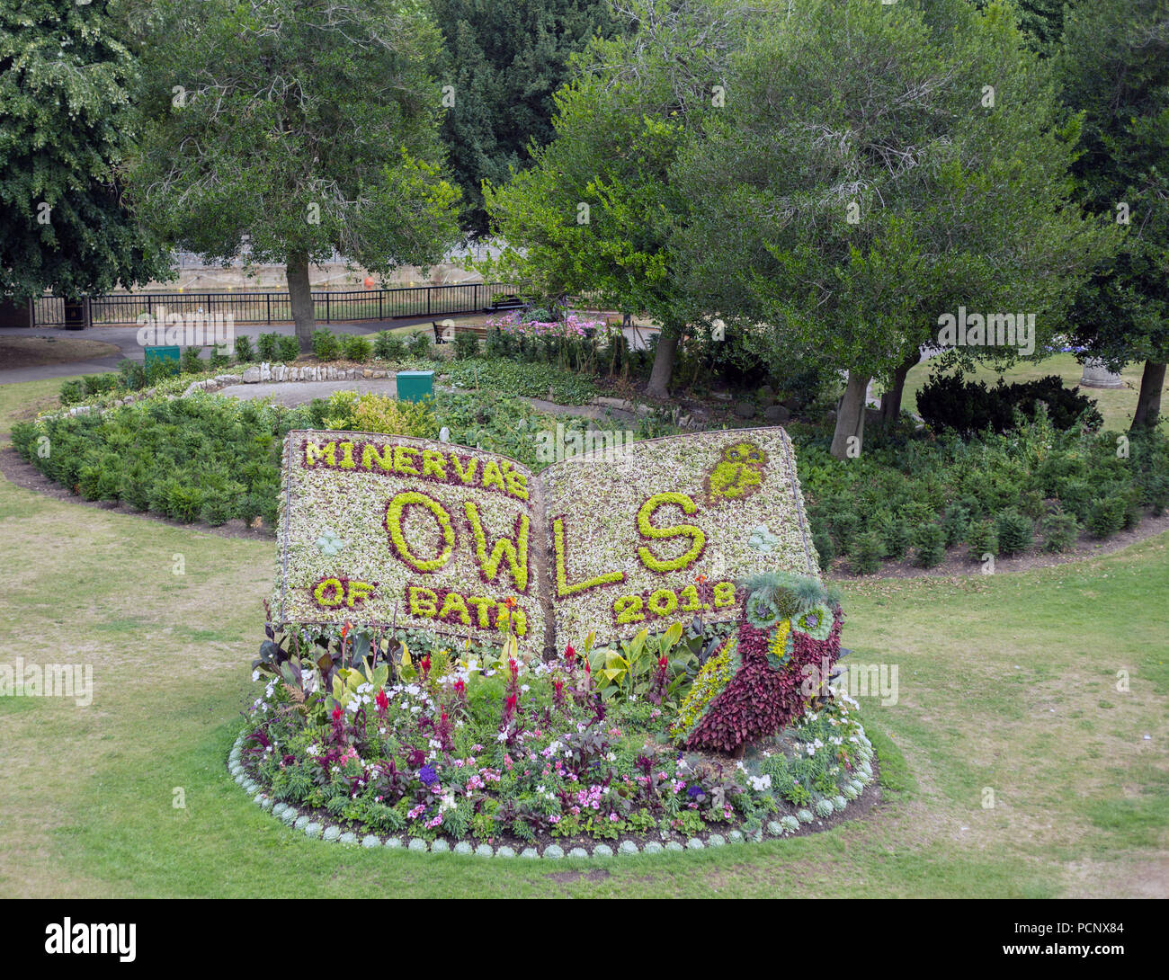 A floral display in Bath's Parade Gardens, forming part of the Minerva's Owls of Bath 2018 sculpture trail. - Stock Image