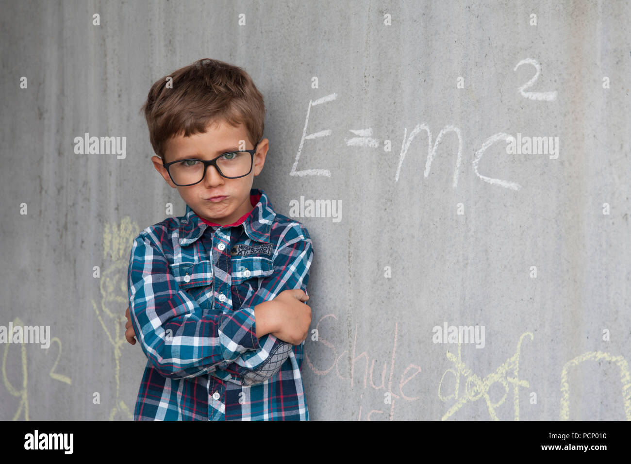 First-grader with glasses and mathematical formula, theory of relativity - Stock Image