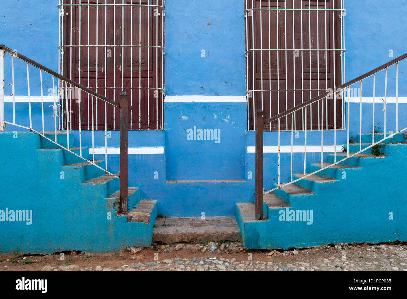 Caribbean, Cuba, Trinidad, two staircases in front of blue exterior facade - Stock Image