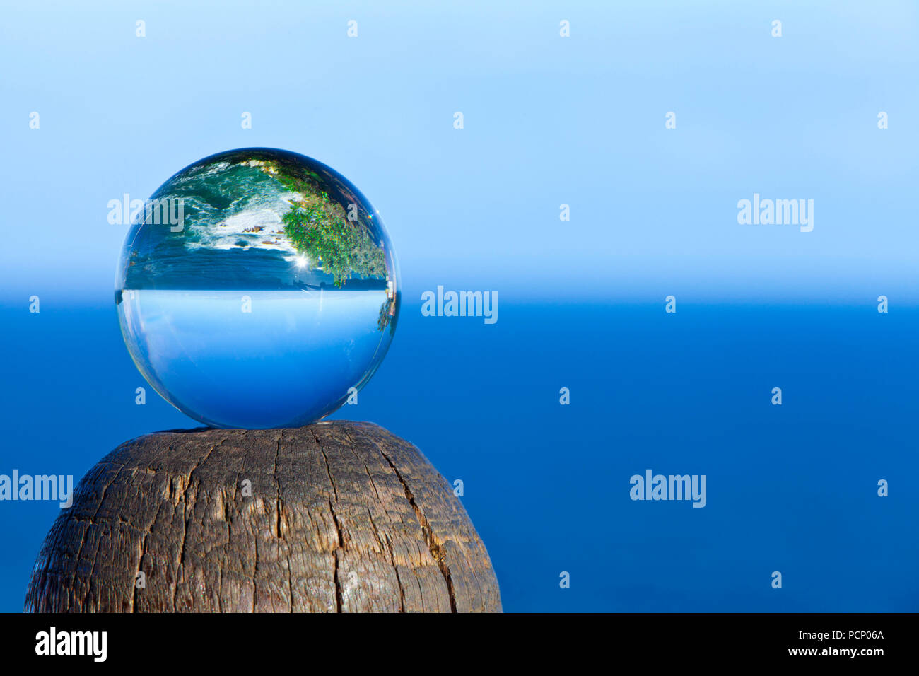 South Africa, Knysna, The Heads, The sea turned upside down in a glass ball - Stock Image
