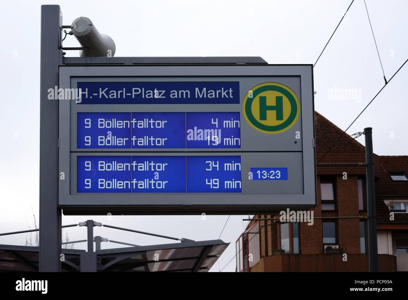 The digital display of a bus stop at Hans-Karl-Platz in Griesheim. - Stock Image