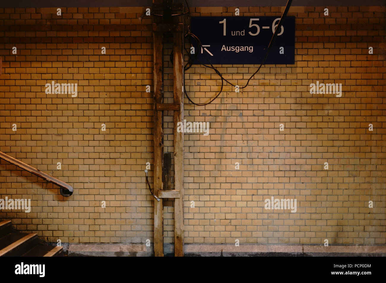 The exit of an old nostalgic station tunnel with tiled walls. - Stock Image
