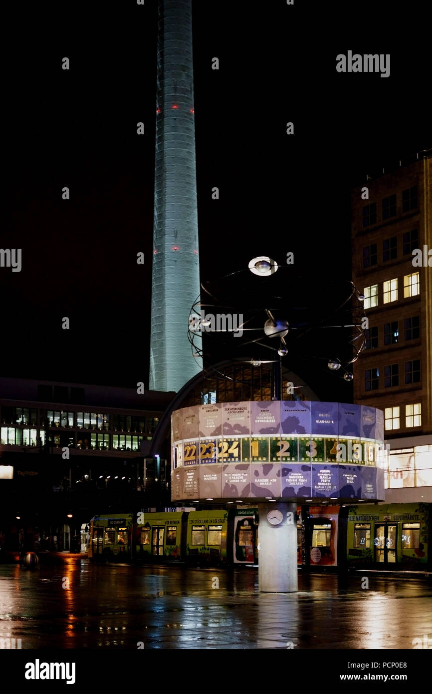 The world time clock at night time in the rain on the Alexanderplatz square in Berlin. Stock Photo
