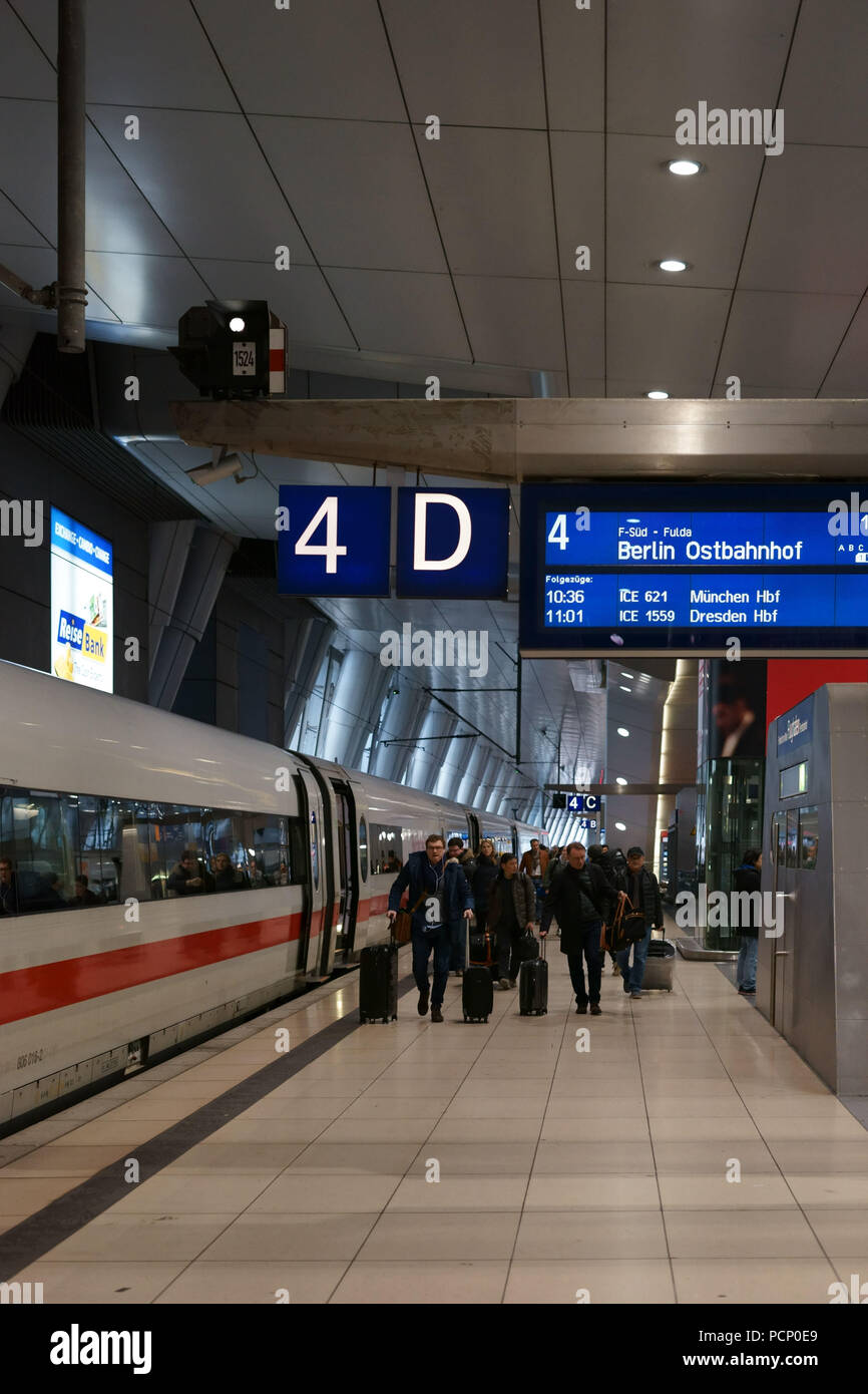 A long-distance train is standing at the stop 'Frankfurt am Main Flughafen'. - Stock Image