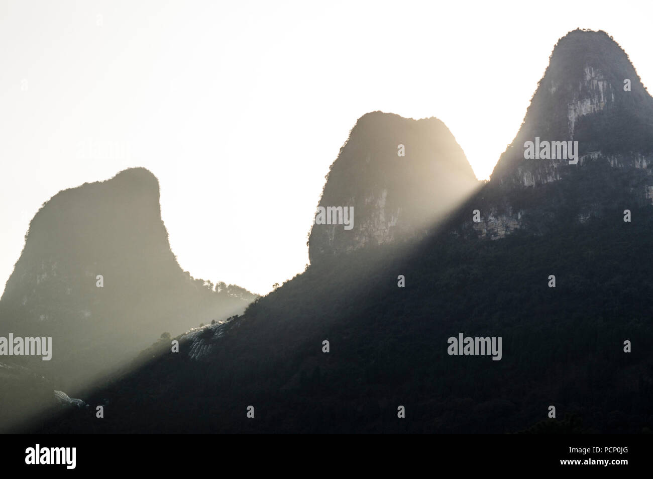 The fascinating hills of Guillin in the evening sun - Stock Image