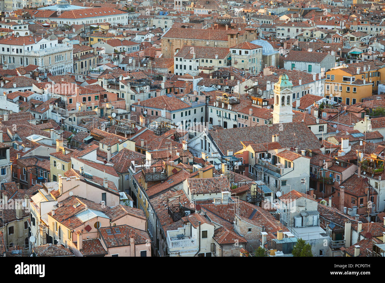 Elevated view of Venice roofs before sunset in summer, Italy - Stock Image