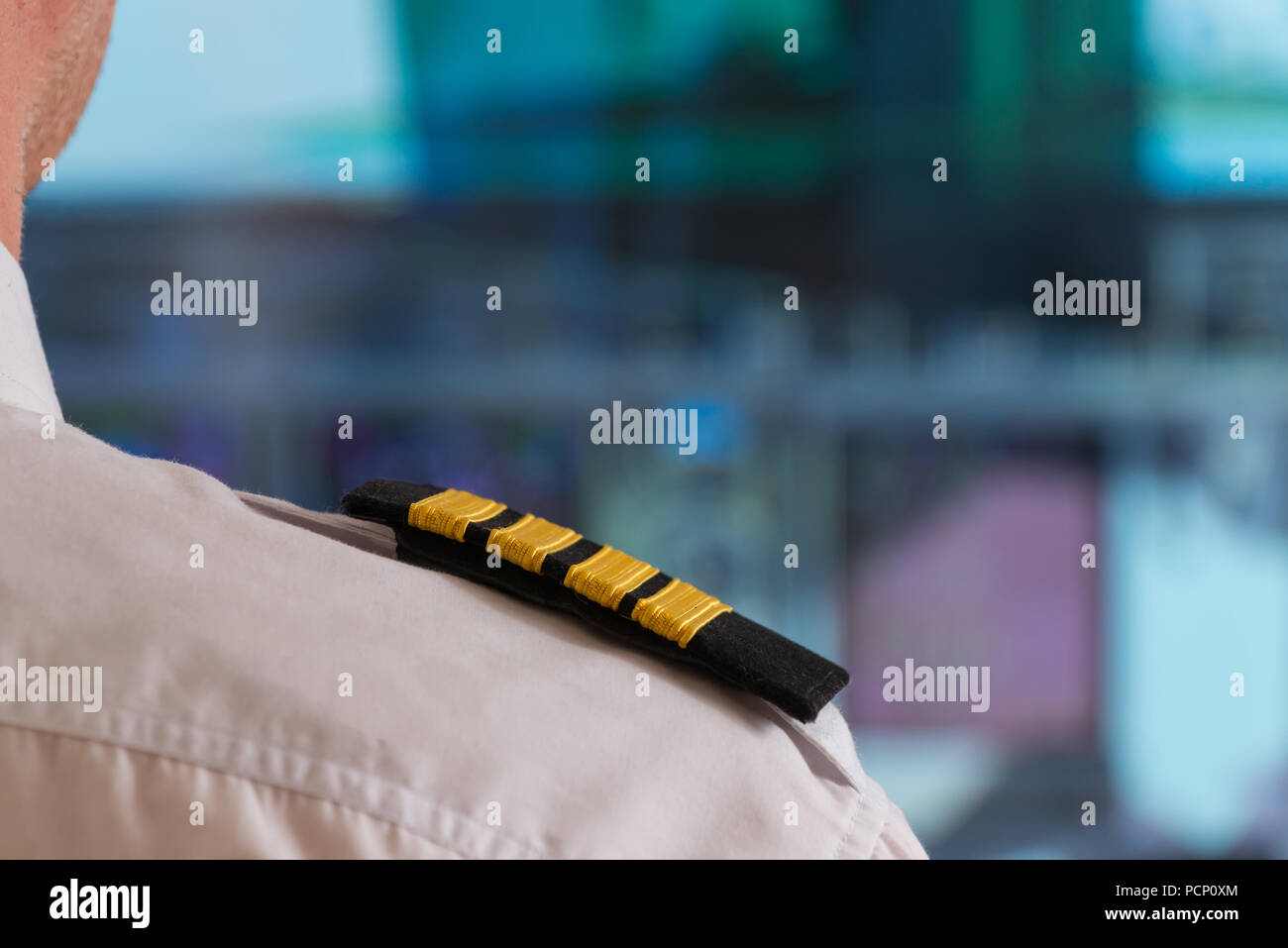 Close up of captain's epaulettes in the cockipt of commercial airplane - Stock Image