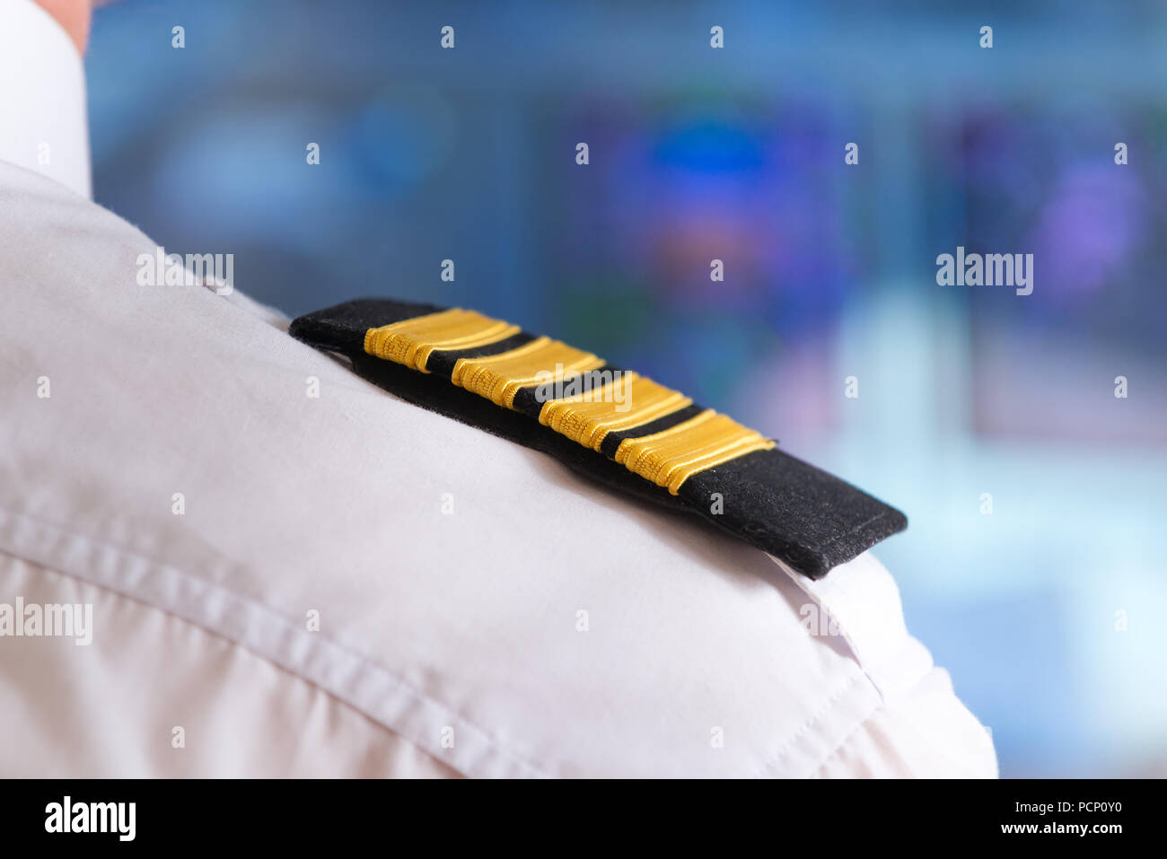 Close up of captain's epaulettes in the cockip of commercial airplane - Stock Image